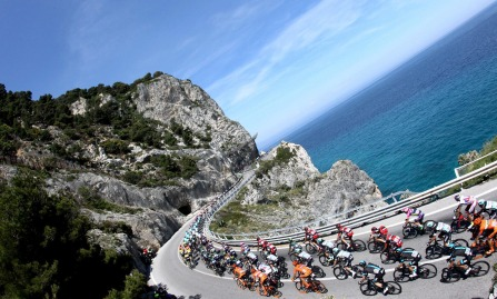 Cyclists compete during the second stage of the Giro d'Italia, Tour of Italy cycling race from Albenga to Genoa, Italy, Sunday, May 10, 2015. Elia Viviani timed his sprint to perfection to win the second stage of the Giro d'Italia Sunday, while Michael Matthews moved into the overall lead on a day dominated by crashes. (Claudio Peri/ANSA via AP)
